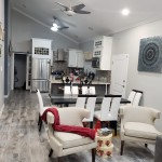 light grey wood look floor tiles in Jamaican home