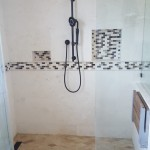 mosaic and travertine tile shower in Jamaica