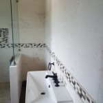 natural stone travertine tile bathroom wall Jamaican home