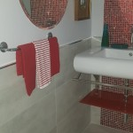red mosaic wall powder room Jamaica