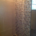 mosaic and ceramic tiles on bathroom wall in Jamaica
