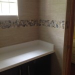 pebble mosaic wood wall tiles in jamaica bathroom 1