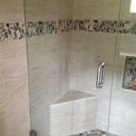 pebble mosaic wood wall tiles in jamaica bathroom