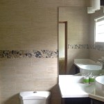 pebble mosaic wood wall tiles in jamaica bathroom 2