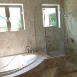 marble look brown tiles in Jamaica bathroom
