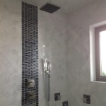 marble wall tiles & silver mosaic shower tiles Jamaica home